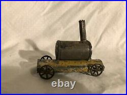 Early Tin Toy Train Steam Engine Toy
